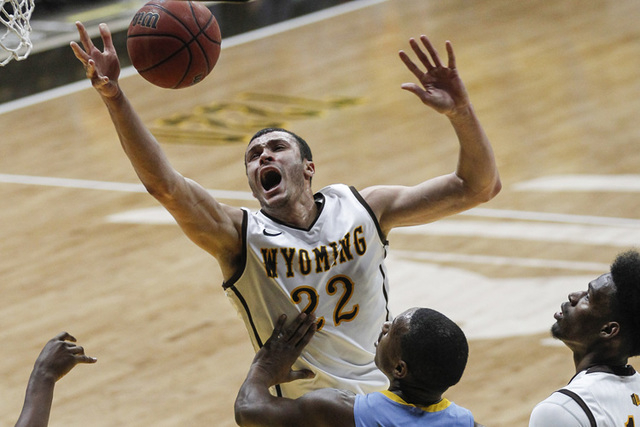 Wyoming Cowboys forward Larry Nance Jr (22) is fouled by Southern Jaguars forward Jared Sam (not shown) during the first half at Arena-Auditorium. (Troy Babbitt/USA TODAY Sports)
