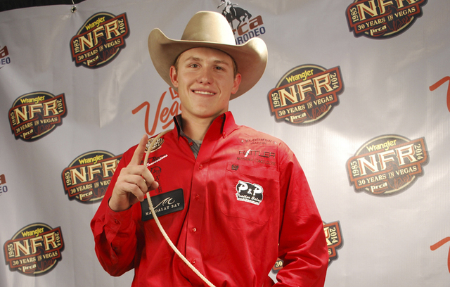 Tie-down roper Marty Yates, 20, was No. 1 in the opening round of the Wrangler National Finals Rodeo with a 7.4-second run that edged superstar Trevor Brazile by one-tenth of a second. (Courtesy N ...
