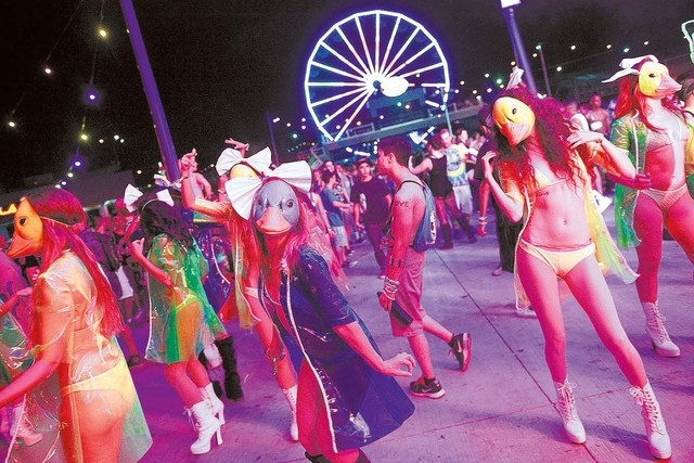 Costumed performers dance in the crowd at the Discovery Stage at the Electric Daisy Carnival at the Las Vegas Motor Speedway in Las Vegas on Friday, June 20, 2014. (Chase Stevens/Las Vegas Review- ...