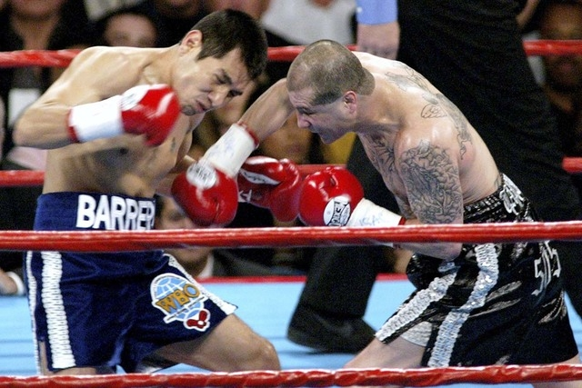 Johnny Tapia, right, slugs Marco Antonio Barrera during their featherweight fight on Nov. 2, 2002, at the MGM Grand Garden. Tapia is the subject of an HBO documentary, and he died of heart failure ...