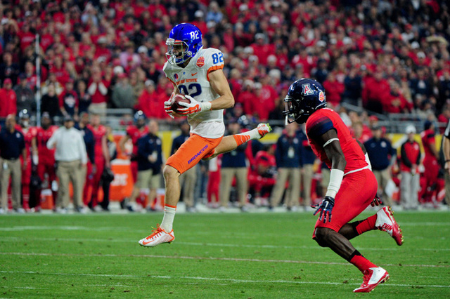 Boise State Broncos wide receiver Thomas Sperbeck (82) makes a catch as Arizona Wildcats safety Tellas Jones (1) defends during the first half in the 2014 Fiesta Bowl at Phoenix Stadium. (Matt Kar ...