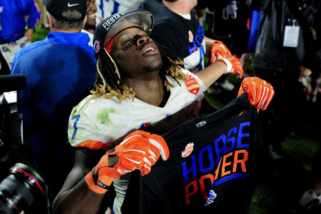 Boise State Broncos running back Jay Ajayi (27) celebrates after beating the Arizona Wildcats 38-30 in the 2014 Fiesta Bowl at Phoenix Stadium. (Matt Kartozian-USA TODAY Sports)
