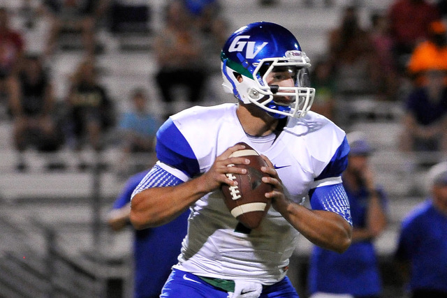 Green Valley quarterback Christian Lopez looks to pass during a high school football game against Palo Verde at Palo Verde High School on Friday, Sept. 5, 2014. (Photo by David Becker/Las Vegas Re ...