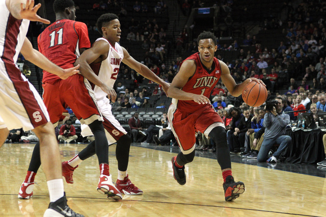 UNLV Runnin' Rebels guard Rashad Vaughn (1) drives against Stanford Cardinals guard Anthony Brown (21) during the second half at Barclays Center. (Brad Penner/USA TODAY Sports)