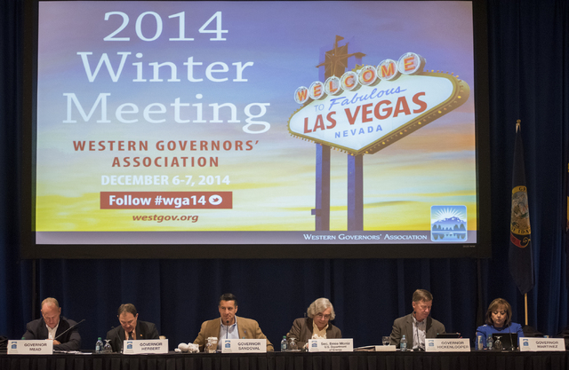 Nevada Gov. Brian Sandoval, third from left, speaks during the 2014 Western Governors Winter meeting at the Four Seasons Hotel in Las Vegas on Saturday, Dec. 6, 2014. On the panal with Sandoval ar ...
