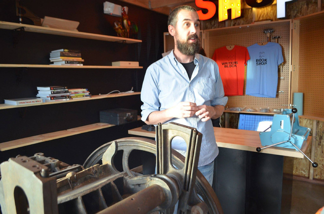 The Writer's Block co-owner Scott Seeley stands in the soon-to-be-completed bookmaking section of the shop during an opening preview Nov. 29. The vintage letterpress is still in need of repair, bu ...