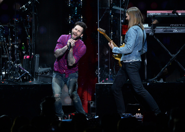 Singer Adam Levine, left, and James Valentine of Maroon 5 perform at Z100 Jingle Ball at Madison Square Garden, Friday, Dec. 12, 2014, in New York. (Photo by Evan Agostini/Invision/AP)