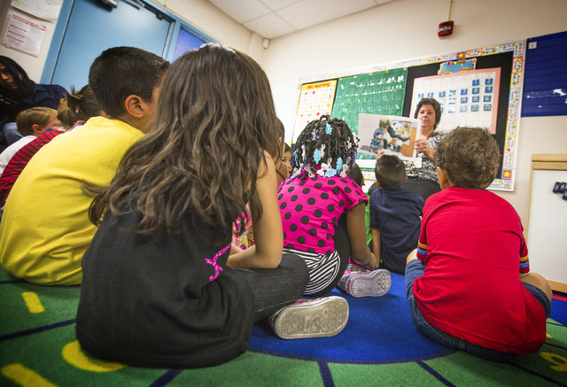Teacher Diane Kelly reads to kindergarten students on the first day of class at Ferron Elementary School, Aug. 25, 2014. Researchers from UNLV are partnering with the Kansas Health Institute, a no ...