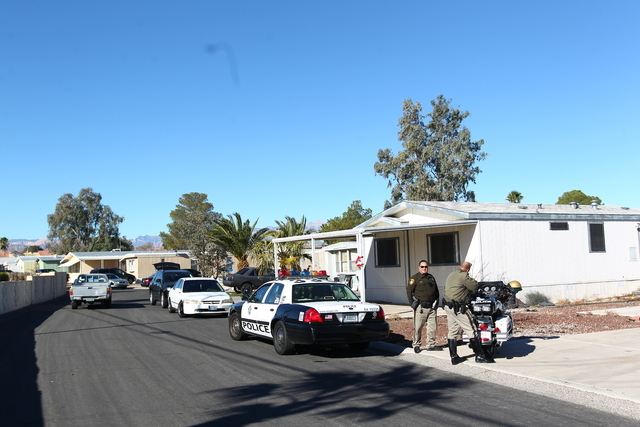 Las Vegas police respond to an incident involving a mother who backed into her 3-year-old child in a mobile home complex at the 6300 block of West Tropicana Avenue  on Wednesday, Jan. 14, 2015.  M ...