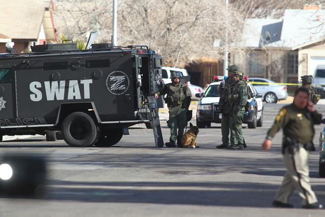 A person refusing to come out of an east valley home after a reported domestic dispute prompted Metro police to send out their SWAT unit and evacuate a neighborhood on Tuesday, Jan. 27, 2015. (Cha ...