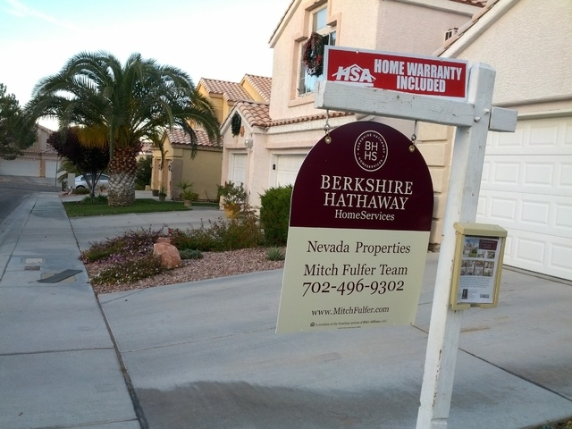 A for-sale sign is seen in front of a Las Vegas home on Dec. 21, 2014. (Las Vegas Review-Journal)