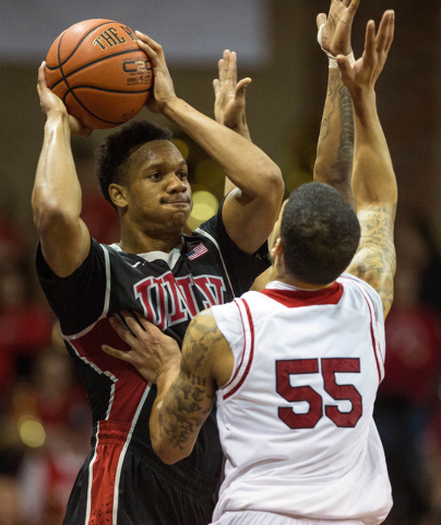 UNLV Rebels guard Rashad Vaughn (1) is guarded by South Dakota Coyotes guard Tyler Larson (55) during the second half at Sanford Pentagon. UNLV defeated South Dakota  75-61 in Sioux Fall on Saturd ...