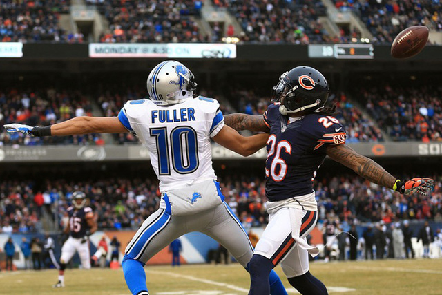Dec 21, 2014; Chicago, IL, USA; Chicago Bears cornerback Tim Jennings (26) pushes Detroit Lions wide receiver Corey Fuller (10) drawing a pass interference flag to set up a Detroit Lions touchdown ...