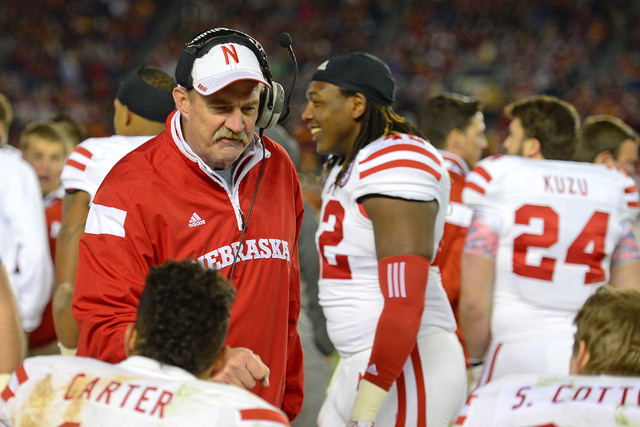 Nebraska Cornhuskers head coach Barney Cotton (L) talks to his players during the fourth quarter against the USC Trojans in the 2014 Holiday Bowl at Qualcomm Stadium. Cotton is UNLV's new offensiv ...
