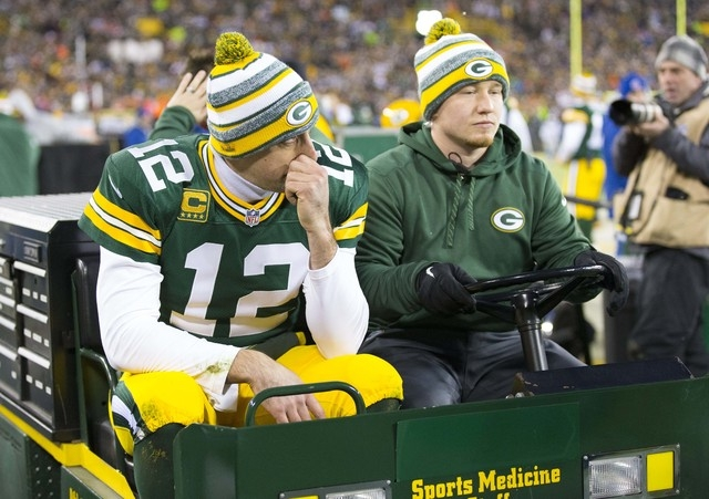 Dec 28, 2014; Green Bay, WI, USA; Green Bay Packers quarterback Aaron Rodgers (12) is driven to the locker room after being injured during the second quarter against the Detroit Lions at Lambeau F ...