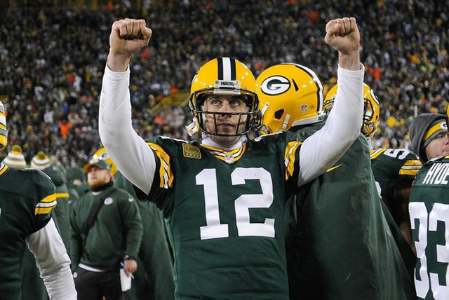 Dec 28, 2014; Green Bay, WI, USA; Green Bay Packers quarterback Aaron Rodgers (12) reacts after officials ruled a 2-point conversion attempt by the Detroit Lions failed in the fourth quarter at La ...
