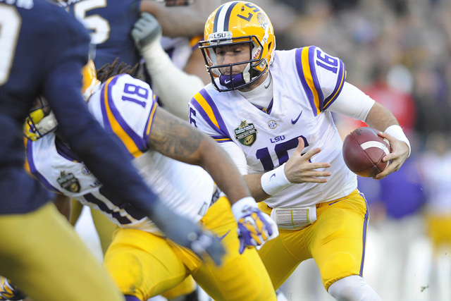 Dec 30, 2014; Nashville, TN, USA; LSU Tigers quarterback Brad Kragthorpe (16) runs on a fake field goal during the first half against the Notre Dame Fighting Irish in the Music City Bowl at LP Fie ...