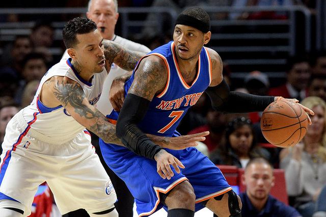Dec 31, 2014; Los Angeles, CA, USA; Los Angeles Clippers forward Matt Barnes (22) guards New York Knicks forward Carmelo Anthony (7) in the second half of the game at Staples Center.  Clippers won ...