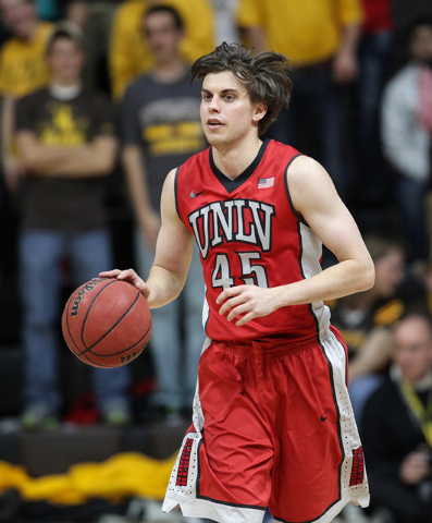 UNLV Runnin' Rebels guard Cody Doolin (45)dribbles the ball against the Wyoming Cowboys during the first half at Arena-Auditorium. The Cowboys defeated the Runnin' Rebels 76-71. (Troy Babbitt-USA  ...