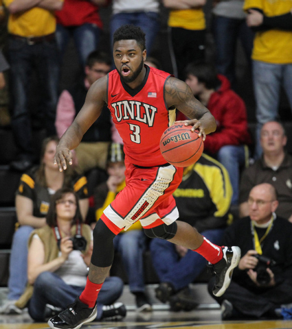 UNLV Runnin' Rebels guard Jordan Cornish (3) brings the ball up court against the Wyoming Cowboys during the first half at Arena-Auditorium. The Cowboys defeated the Runnin' Rebels 76-71.  (Troy B ...