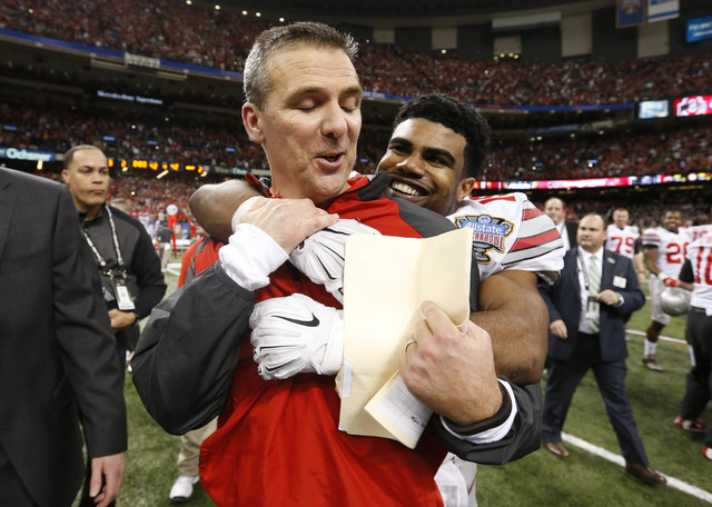 Jan 1, 2015; New Orleans, LA, USA; Ohio State Buckeyes head coach Urban Meyer is hugged by running back Ezekiel Elliott (15) after the 2015 Sugar Bowl against the Alabama Crimson Tide at Mercedes- ...