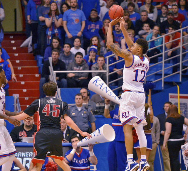 Kansas Jayhawks guard Kelly Oubre Jr. (12) shoots during the first half against the UNLV Rebels at Allen Fieldhouse, Sunday, Jan. 4, 2015. (Denny Medley/USA TODAY Sports)
