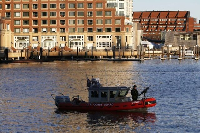 A U.S. Coast Guard boat patrols the waters outside the federal courthouse on the first day of jury selection in the trial of accused Boston Marathon bomber Dzhokhar Tsarnaev in Boston, Massachuset ...
