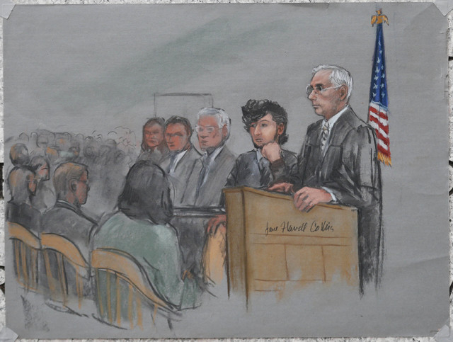 Accused Boston Marathon bomber Dzhokhar Tsarnaev (2nd R) is shown in a courtroom sketch next to Judge George O'Toole (R) on the first day of jury selection at the federal courthouse in Boston, Mas ...