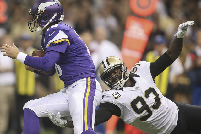 New Orleans Saints outside linebacker Junior Galette (93) reaches for Minnesota Vikings quarterback Matt Cassel in the first quarter at Mercedes-Benz Superdome in New Orleans, in this file photo t ...