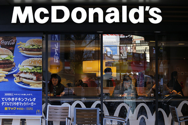 Visitors are seen inside a McDonald's store in Tokyo January 7, 2015. (Issei Kato/Reuters)