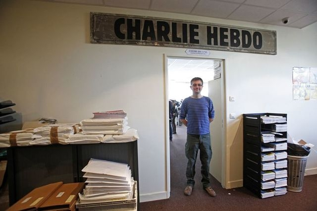 French cartoonist Charb, publishing director of French satirical weekly Charlie Hebdo, poses for photograph at the magazines offices in Paris in September 19, 2012. Reports say that he was killed  ...