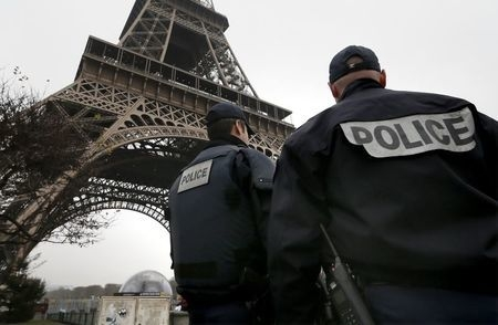 """French police patrol near the Eiffel Tower in Paris as part of the highest level of """"Vigipirate"""" security plan after a shooting at the Paris offices of Charlie Hebdo, Wednesday, Jan. 7, 2015. (Reu ..."""