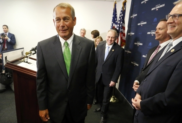 U.S. House Speaker John Boehner, R-Ohio, left, departs at the end of a news conference following a Republican caucus meeting at the U.S. Capitol in Washington, Wednesday, Jan. 7, 2015. (Reuters/Jo ...