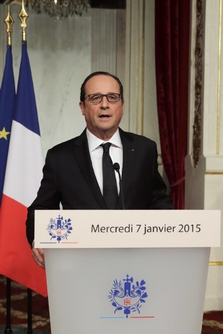 French President Francois Hollande delivers a speech at the Elysee Palace after a shooting at the Paris headquarters of satirical weekly Charlie Hebdo killing at least 12 people and injuring many, ...