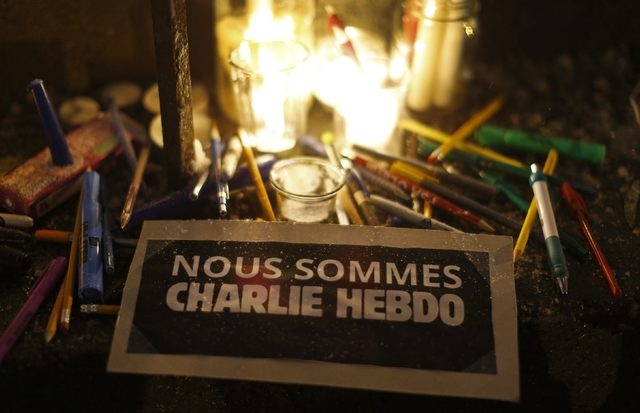 A sign is pictured on the steps of the French consulate during a vigil for the victims of a shooting by gunmen at the offices of weekly satirical magazine Charlie Hebdo in Paris in Quebec City, We ...