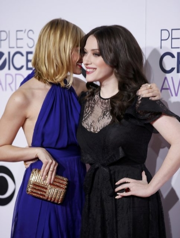 """Actresses Beth Behrs (L) and Kat Dennings from the CBS sitcom """"2 Broke Girls"""" arrive at the 2015 People's Choice Awards in Los Angeles, California January 7, 2015.  REUTERS/Danny Moloshok"""