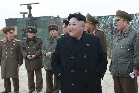North Korean leader Kim Jong Un guides the multiple-rocket launching drill of women's sub-units under KPA Unit 851 in Pyongyang in this undated photo released Dec. 30, 2014. (REUTERS/Korean Centra ...
