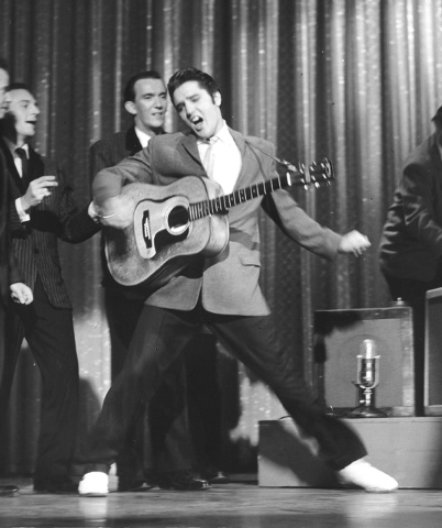 Elvis Presley performs on stage at The Ed Sullivan Show in Hollywood, California in this handout photo from 1956, courtesy of The Elvis Presley Estate. Presley would have been 80 years old on Janu ...