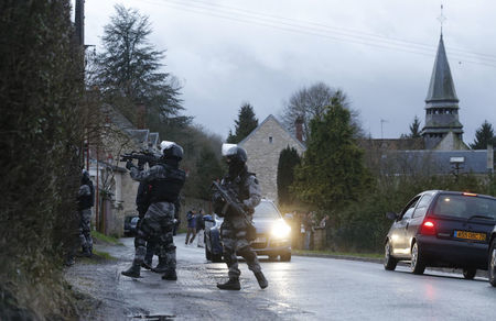 Members of the French GIPN intervention police forces secure a neighbourhood in Corcy, northeast of Paris, Thursday, Jan. 8, 2015. (Reuters/Christian Hartmann )
