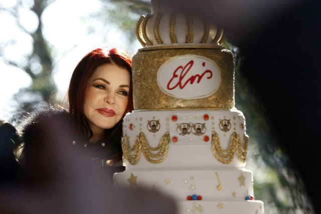 Priscilla Ann Presley, the ex-wife of the late singer Elvis Presley, cuts a birthday cake during a proclamation of Elvis Presley Day by Memphis and Shelby County officials at Graceland in Memphis, ...