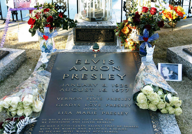 Flowers and birthday wishes from around the world lie beside the grave of Elvis Presley at his home at Graceland in Memphis, Tennessee, January 8, 2015.  Over 1,000 fans from around the world brav ...