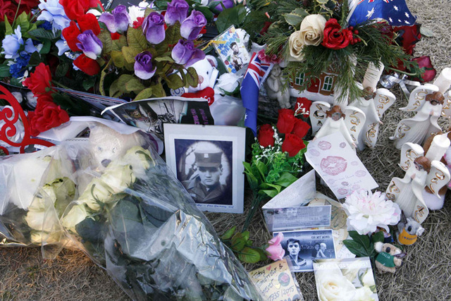 Flowers and birthday wishes from around the world lie beside the grave of Elvis Presley at his home at Graceland in Memphis, Tennessee, January 8, 2015.  Over 1,000 fans from around the world were ...
