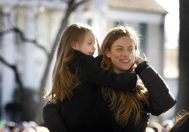 Riley Keough holds her little sister Finley Lockwood in front of Graceland during a proclamation of Elvis Presley Day by Memphis and Shelby County officials at Graceland in Memphis, Tennessee Janu ...