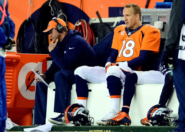 Jan 11, 2015; Denver, CO, USA; Denver Broncos quarterback Peyton Manning (18) and offensive coordinator Adam Gase on the sideline during the fourth quarter in the 2014 AFC Divisional playoff footb ...