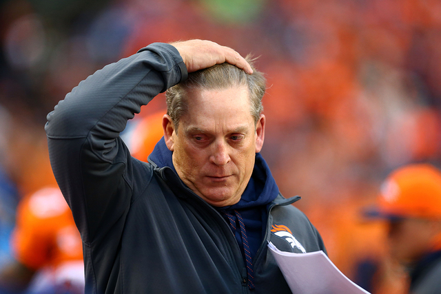 Jan 11, 2015; Denver, CO, USA; Denver Broncos defensive coordinator Jack Del Rio reacts in the first half against the Indianapolis Colts in the 2014 AFC Divisional playoff football game at Sports  ...