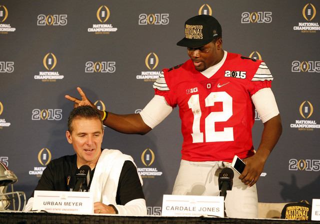 Ohio State Buckeyes quarterback Cardale Jones (12) jokes around with Ohio State Buckeyes head coach Urban Meyer during a press conference after beating the Oregon Ducks in the 2015 CFP National Ch ...