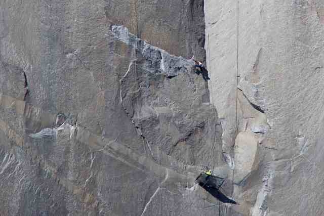 Climber Kevin Jorgeson (shirtless) climbs Pitch 17 as his partner Tommy Caldwell belays from below on the Dawn Wall of the El Capitan rock formation in Yosemite National Park California in this Ja ...