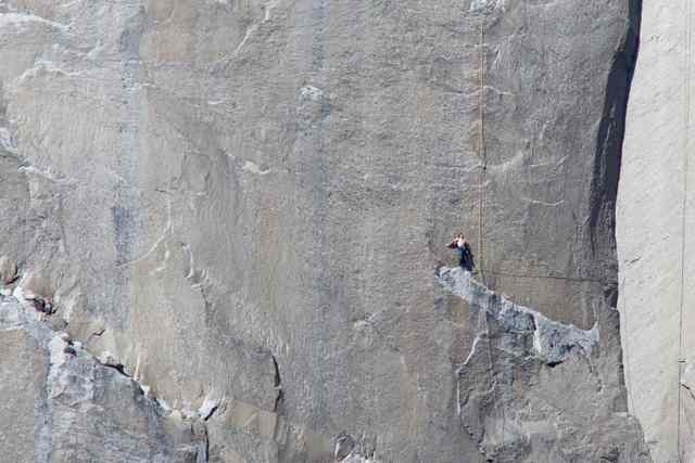Climber Kevin Jorgeson looks up from Pitch 18 on the Dawn Wall of the El Capitan rock formation in Yosemite National Park, California in this January 12, 2015 handout photo released to Reuters Jan ...