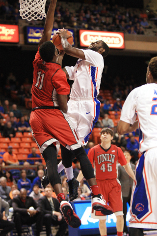 Jan 13, 2015; Boise, ID, USA; Boise State Broncos guard Mikey Thompson (1) drives to the basket against UNLV Rebels forward Goodluck Okonoboh (11) during first half action at Taco Bell Arena . Man ...