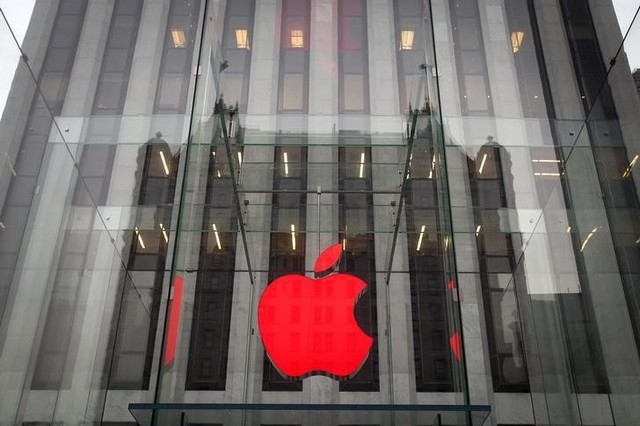The Apple logo is illuminated in red at the Apple Store on 5th Avenue in the Manhattan borough of New York.  (REUTERS/Carlo Allegri)
